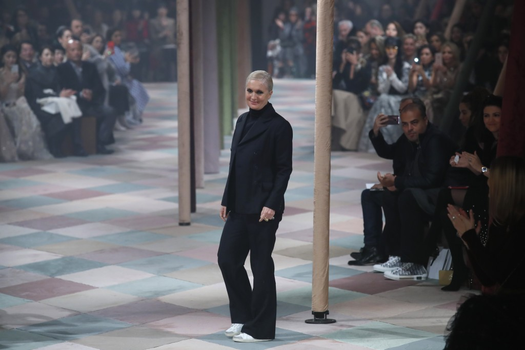 Designer Maria Grazia Chiuri accepts applause at the end of the Dior Spring/Summer 2019 Haute Couture fashion collection presented in Paris, Monday Ja