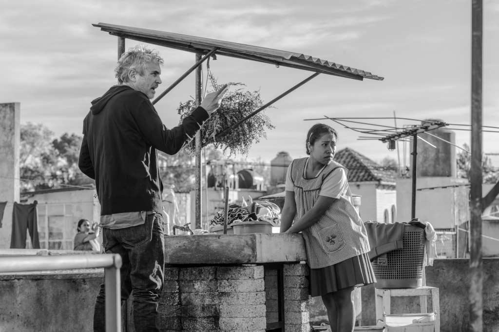 "This image released by Netflix shows filmmaker Alfonso Cuaron, left, and Yalitza Aparicio on the set of ""Roma."" On Tuesday, Jan. 22, 2019, Cuaron was"