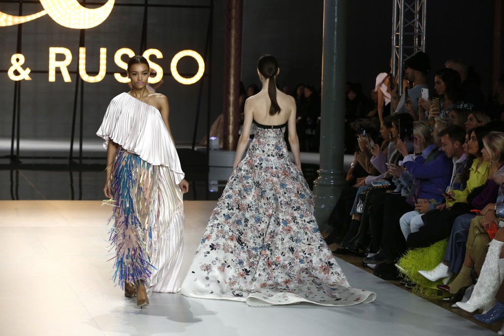 Models wear creations for the Ralph & Russo Spring/Summer 2019 Haute Couture fashion collection presented in Paris, Monday Jan. 21, 2019. (AP Photo/Mi