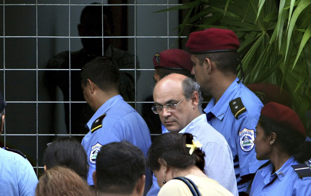 FILE - In this Oct. 11, 2008 file photo, journalist Carlos Fernando Chamorro, who runs the Communication Research Center, Cinco, is surrounded by the