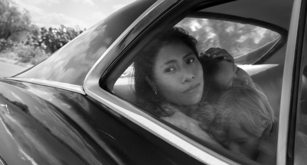 "This image released by Netflix shows Yalitza Aparicio in a scene from the film ""Roma,"" by filmmaker Alfonso Cuaron. On Tuesday, Jan. 22, 2019, Aparici"