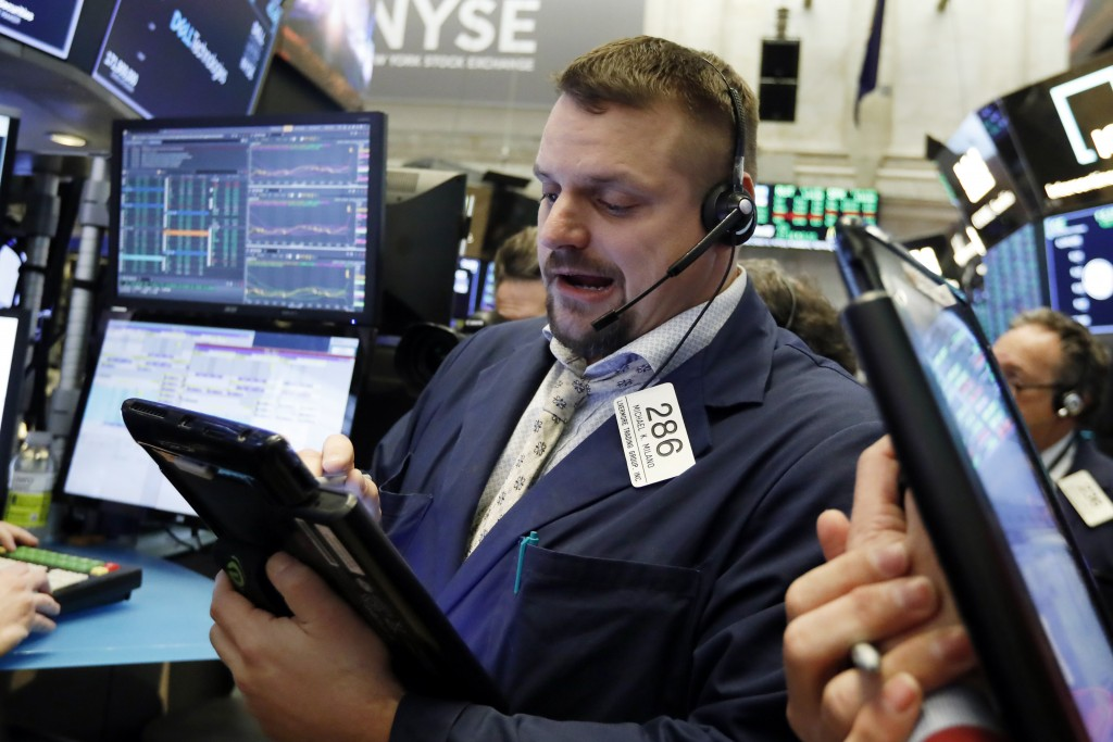 FILE- In this Jan. 18, 2019, file photo trader Michael Milano works on the floor of the New York Stock Exchange. The U.S. stock market opens at 9:30 a...