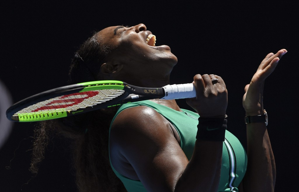 United States' Serena Williams reacts after losing a point to Karolina Pliskova of the Czech Republic during their quarterfinal match at the Australia...
