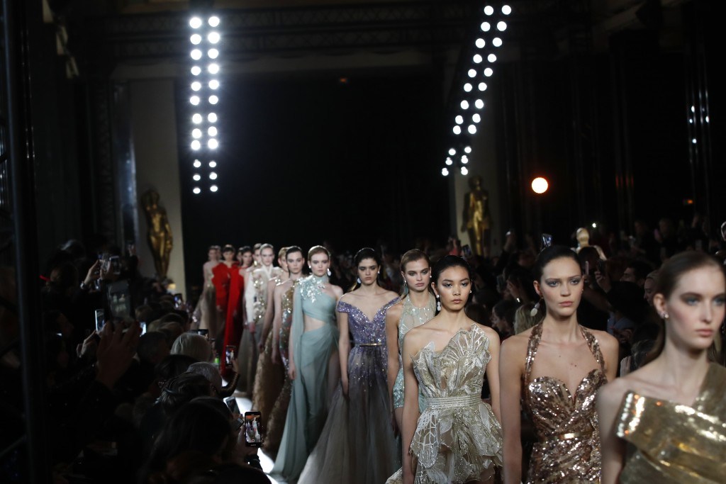 Models wear creations for the Elie Saab Spring/Summer 2019 Haute Couture fashion collection presented in Paris, Tuesday Jan. 22, 2019. (AP Photo/Chris...