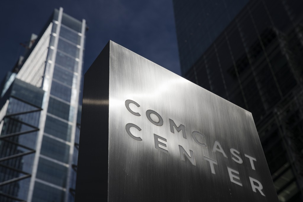 FILE- This May 21, 2018, file photo shows a sign outside the Comcast Center in Philadelphia. Comcast Corp. reports financial results Wednesday, Jan. 2