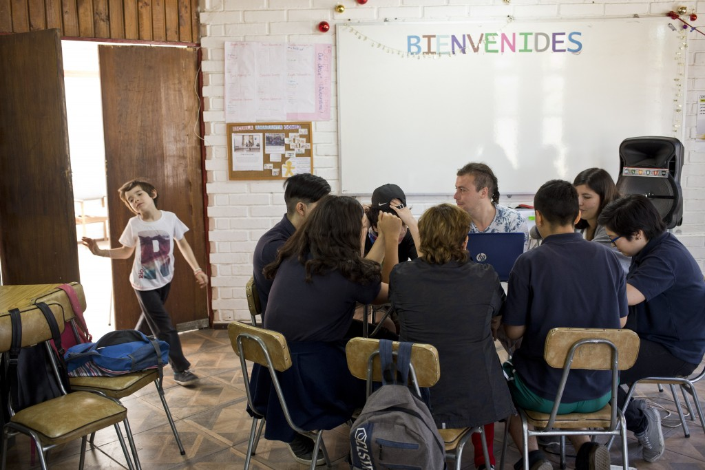 In this Dec.13, 2018 photo, transgender student Laura, left, enters a classroom at the Amaranta Gomez school in Santiago, Chile. Students agreed that