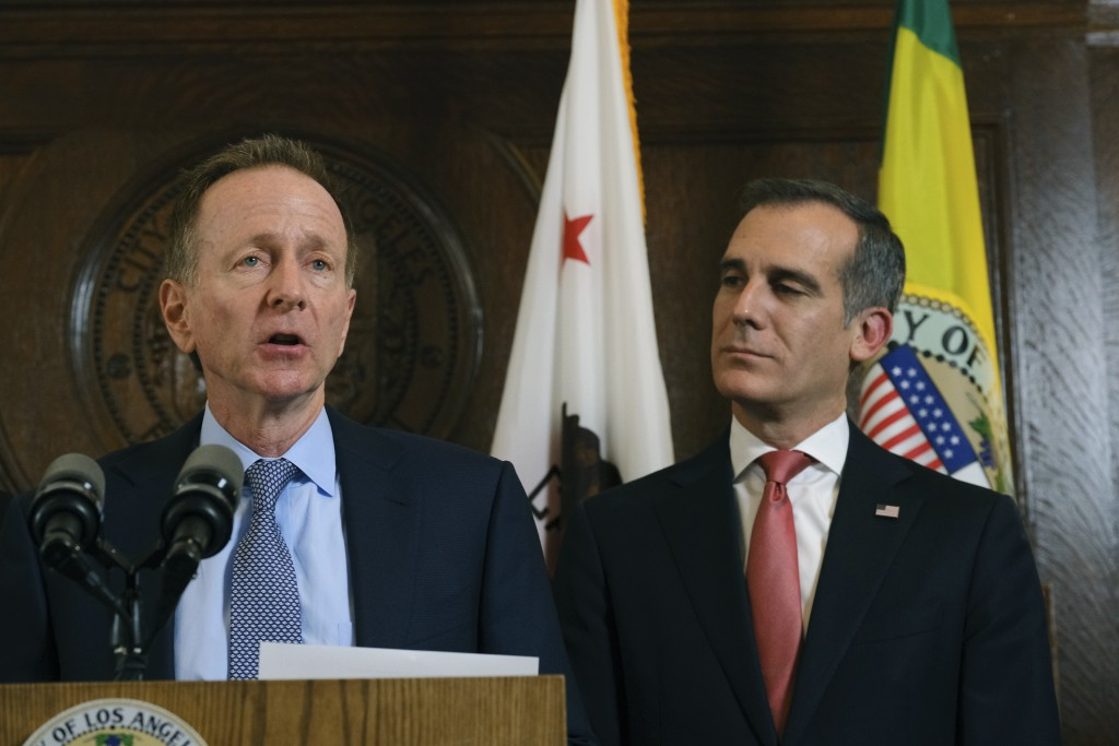 Austin Beutner, left, Superintendent of the Los Angeles Unified School District, speaks during a news conference as Los Angeles Mayor Eric Garcetti, r...
