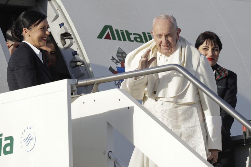 Pope Francis boards an airplane on his way to Panama, at Rome's Fiumicino international airport, Wednesday, Jan. 23, 2019. History's first Latin Ameri