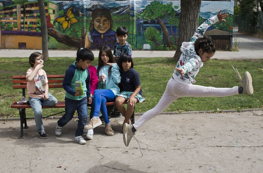 In this Dec. 11, 2018 photo, Violeta, a transgender girl, jumps during recess at the Amaranta Gomez school in Santiago, Chile. Students agreed that th
