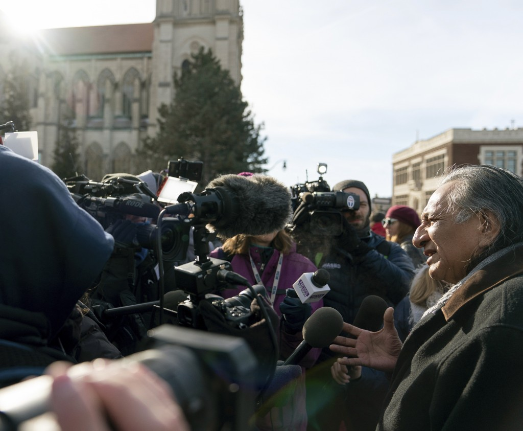 Guy Jones speaks to the press during a gathering in front of the Catholic Diocese in Covington, Ky., Tuesday, Jan. 22, 2019. Jones organized Tuesday's