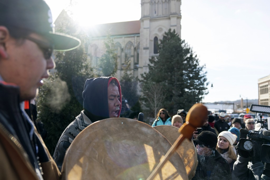 Sleepy Eye Lafromboise, center, and his son Eshtakaba, both of the Sioux Nation, sing during a gathering of Native American supporters in front of the