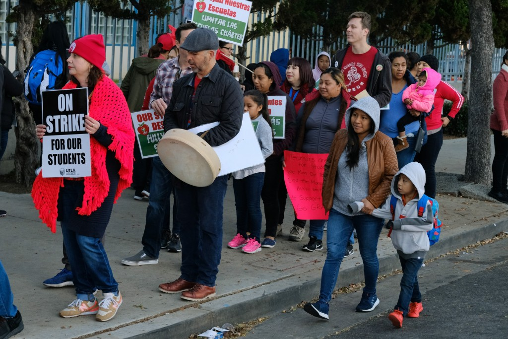 Parents arrive with their children to Evelyn Thurman Gratts Elementary School as people rally in support of Los Angeles school teachers Tuesday, Jan. ...