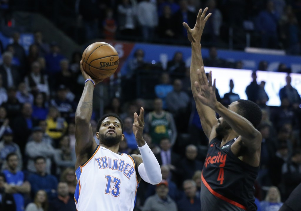 Oklahoma City Thunder forward Paul George (13) shoots in front of Portland Trail Blazers forward Maurice Harkless (4) in the first half of an NBA bask...