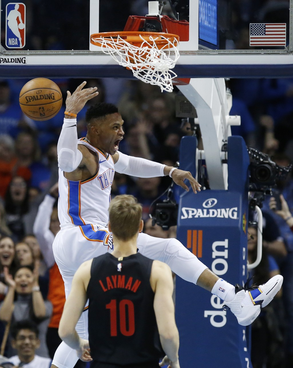 Oklahoma City Thunder guard Russell Westbrook. left, celebrates a dunk in front of Portland Trail Blazers forward Jake Layman (10) in the second half ...