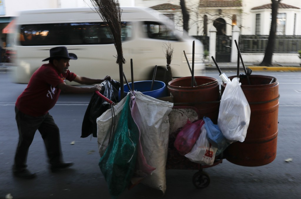 "A garbage collector pushes his cart along a street in the Roma Sur neighborhood of Mexico City, Wednesday, Dec. 19, 2018. News of Alfonso Cuaron's ""Ro"