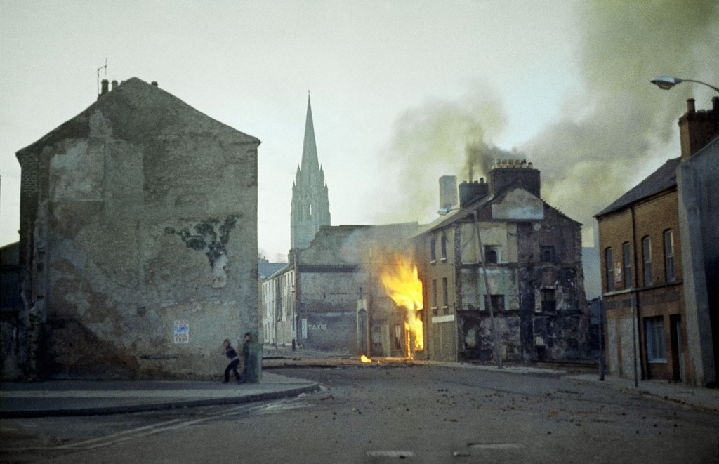FILE - In this February 1972 file photo, a building burns in the bogside district of Londonderry, Northern Ireland, in the aftermath of Bloody Sunday,