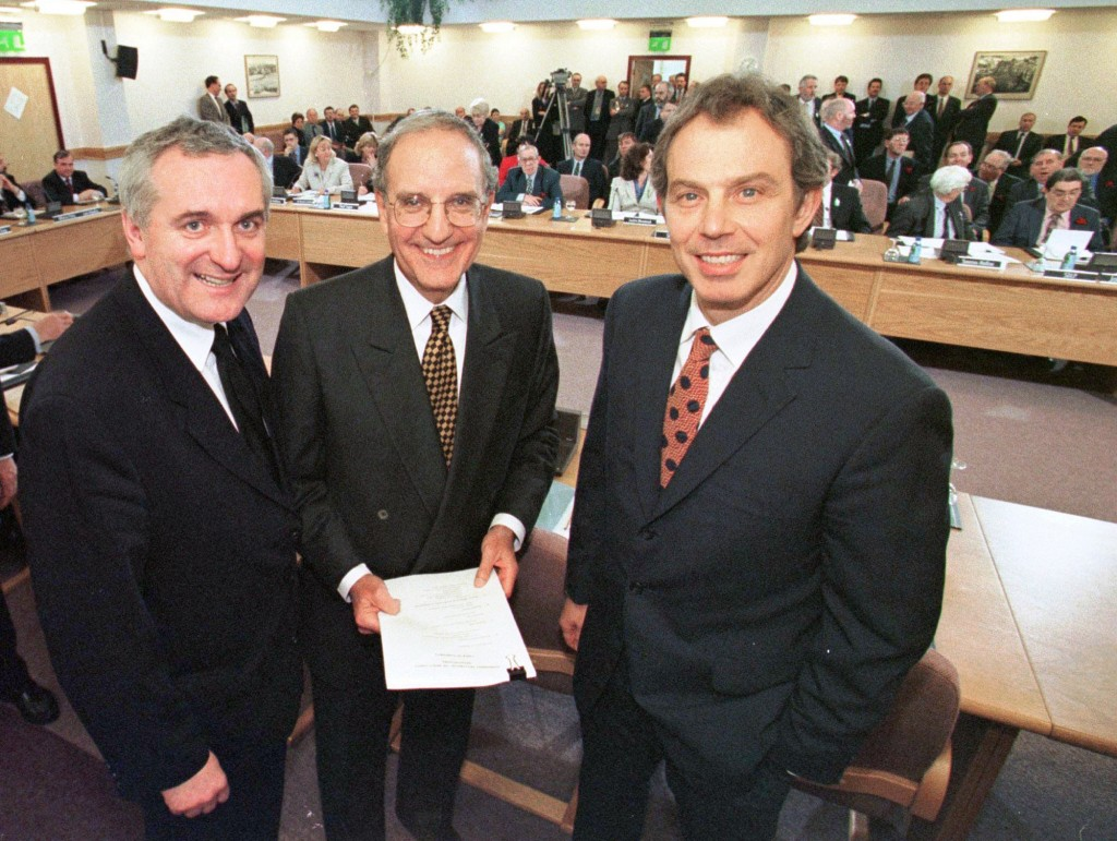 FILE - In this April 10, 1998, file photo, from right, British Prime Minister Tony Blair, U.S. Sen. George Mitchell, and Irish Prime Minister Bertie A