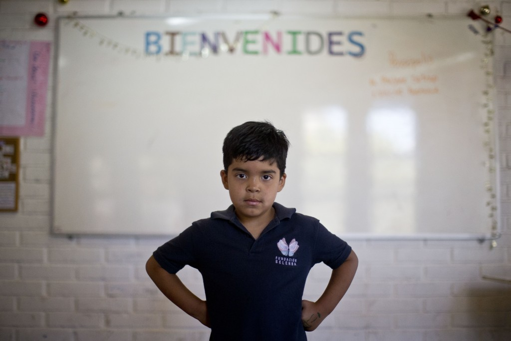 "In this Dec.12, 2018 photo, Alexis, a transgender boy, poses for a photo at the Amaranta Gomez school in Santiago, Chile. ""I'm happy here because ther"