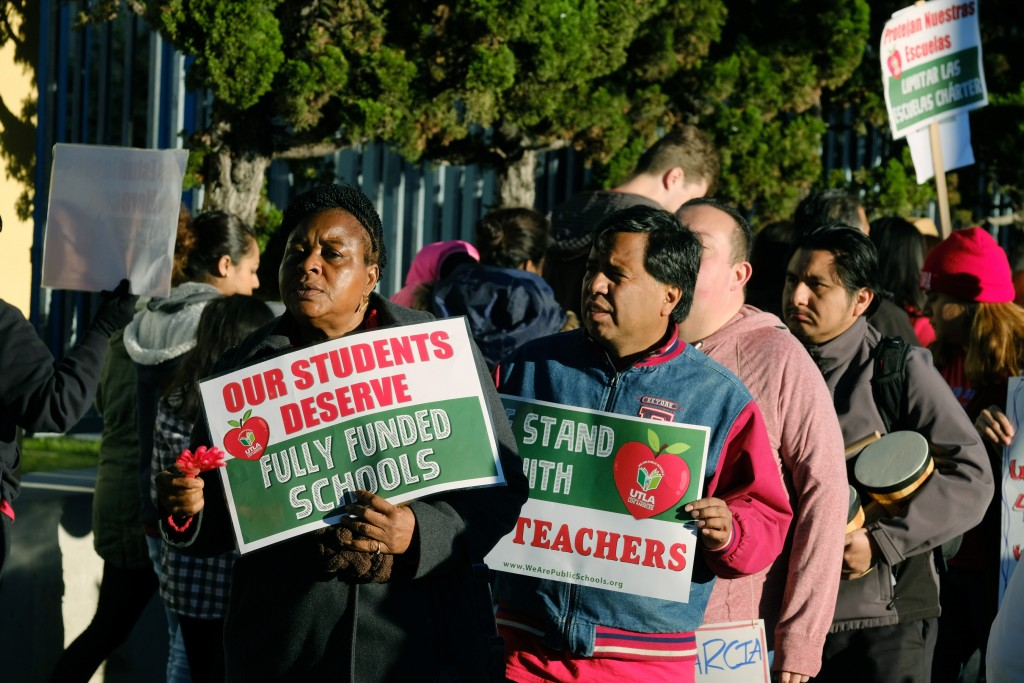 Teachers and parents rally in support of Los Angeles school teachers Tuesday, Jan. 22, 2019, in Los Angeles. A tentative deal was reached Tuesday betw...
