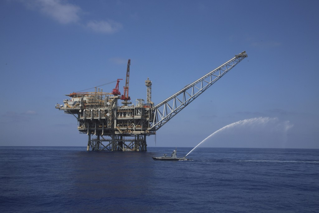 In this Sept. 2, 2015 photo, a rig is seen in the Tamar natural gas field in the Mediterranean Sea, off the coast of Israel. The discovery of natural