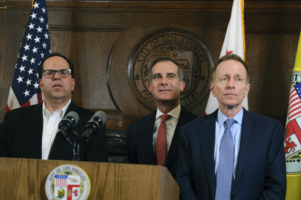 From left, Union President Alex Caputo-Pearl, Austin Beutner, Superintendent of the Los Angeles Unified School District, and Los Angeles Mayor Eric Ga...