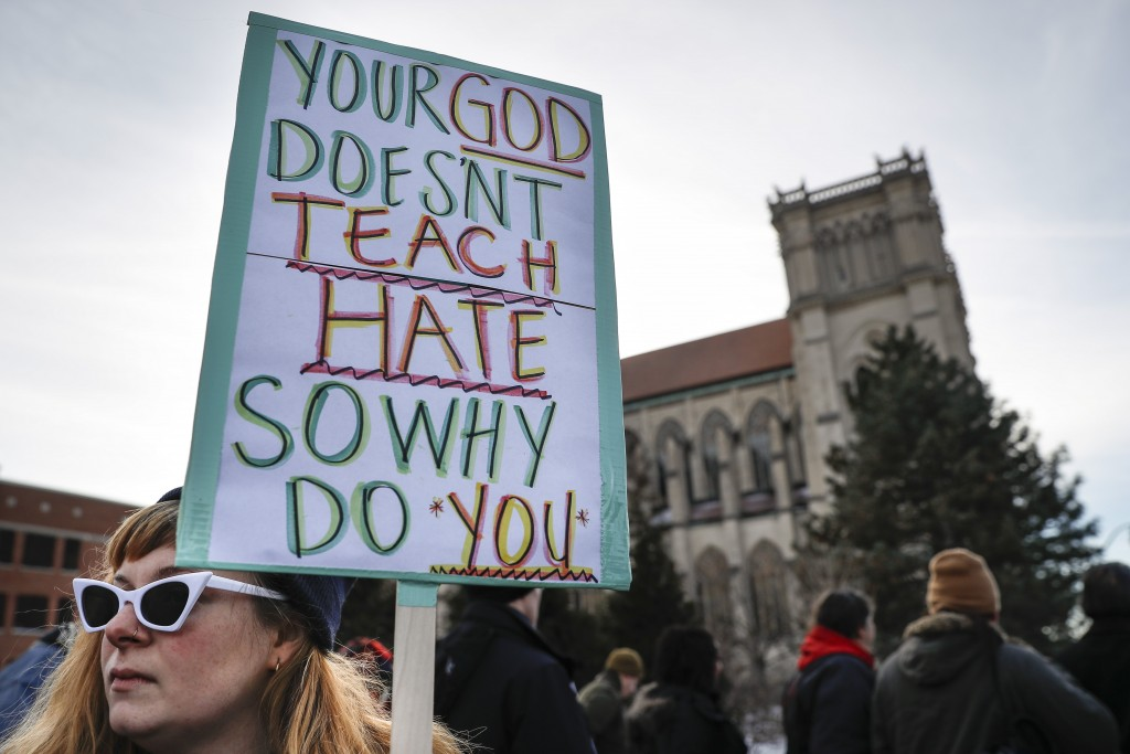 Protestors gather outside the Catholic Diocese of Covington Tuesday, Jan. 22, 2019, in Covington, Ky. The diocese in Kentucky has apologized after vid