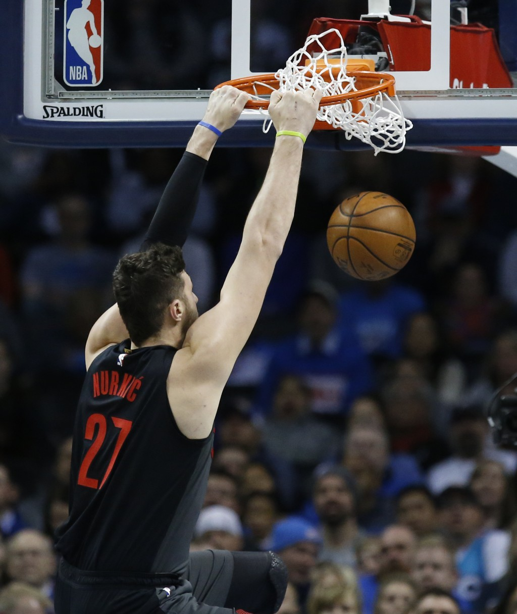 Portland Trail Blazers center Jusuf Nurkic (27) dunks in the first half of an NBA basketball game against the Oklahoma City Thunder in Oklahoma City, ...