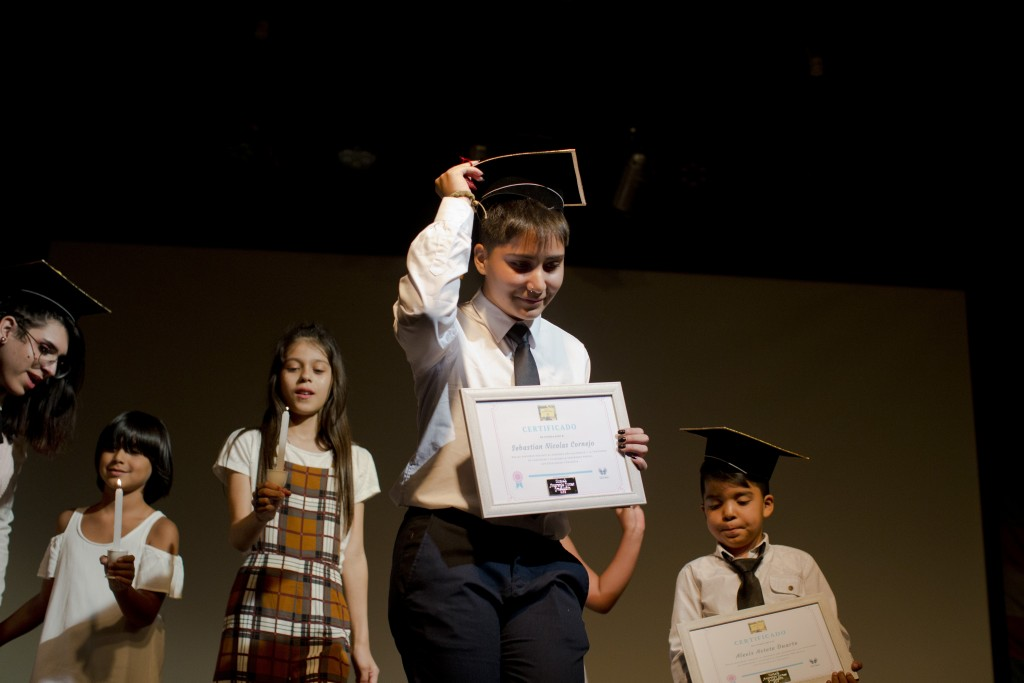 In this Dec.18, 2018 photo, transgender student Sebastian, center, carries his diploma after his graduation ceremony at the Amaranta Gomez school in S