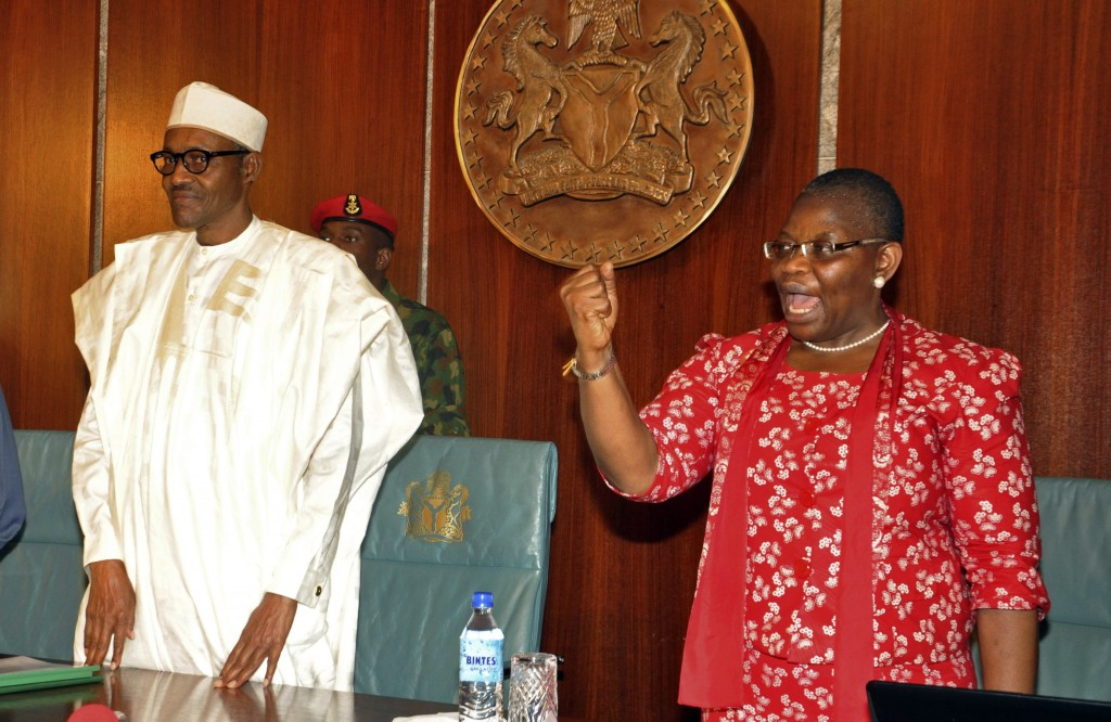 FILE - In this Wednesday, July 8, 2015 file photo, Nigerian President Muhammadu Buhari, left, stands next to Oby Ezekwesili, a coordinator of the 'Bri