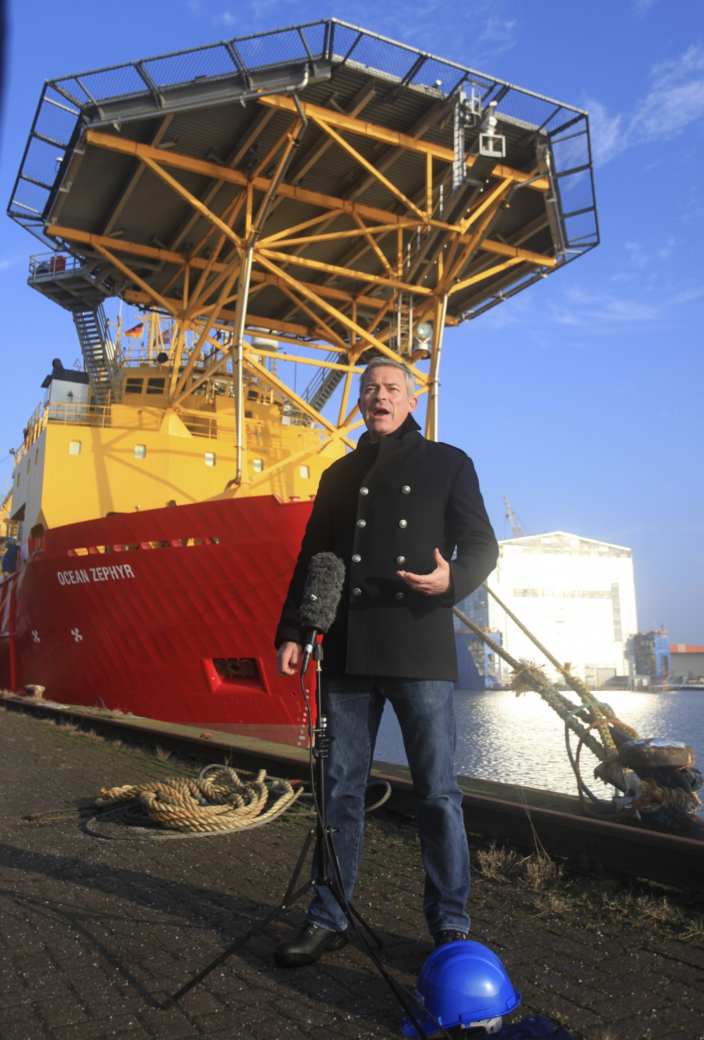 Oliver Steeds, head of the Nekton Mission is interviewed in front of the Ocean Zephyr in the docks in Bremerhaven, Germany, Wednesday Jan. 23, 2019. T