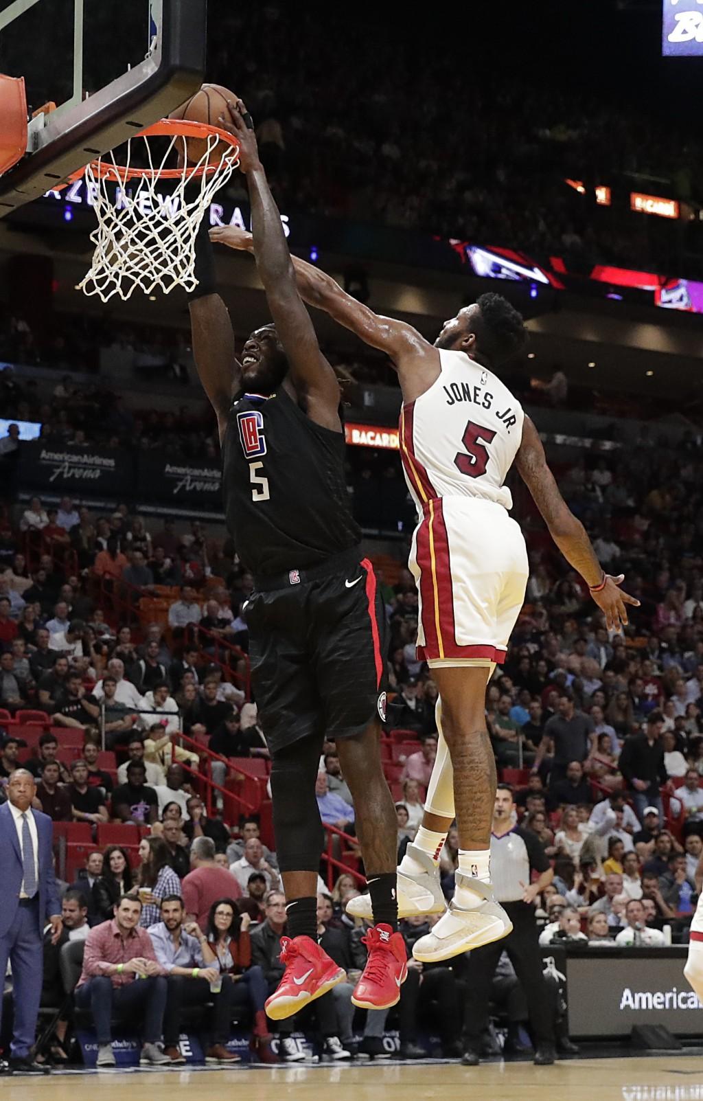 Los Angeles Clippers forward Montrezl Harrell dunks the ball against Miami Heat forward Derrick Jones Jr. (5) during the first half of an NBA basketba...