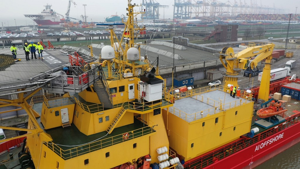 In this image taken from drone video people stand on the helipad, top left, of the Ocean Zephyr in the docks in Bremerhaven, Germany, Wednesday Jan. 2