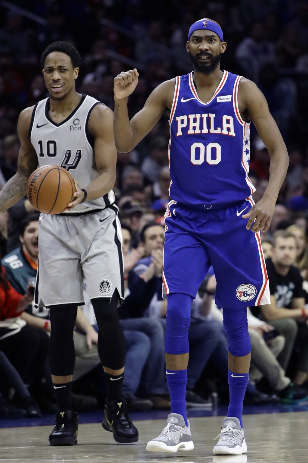 Philadelphia 76ers' Corey Brewer (00) reacts after forcing a turnover by San Antonio Spurs' DeMar DeRozan (10) during the first half of an NBA basketb...