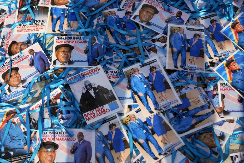 Supporters of Congolese President elect Felix Tshisekedi sell souvenirs outside his party headquarters in Kinshasa, Democratic Republic of the Congo, ...
