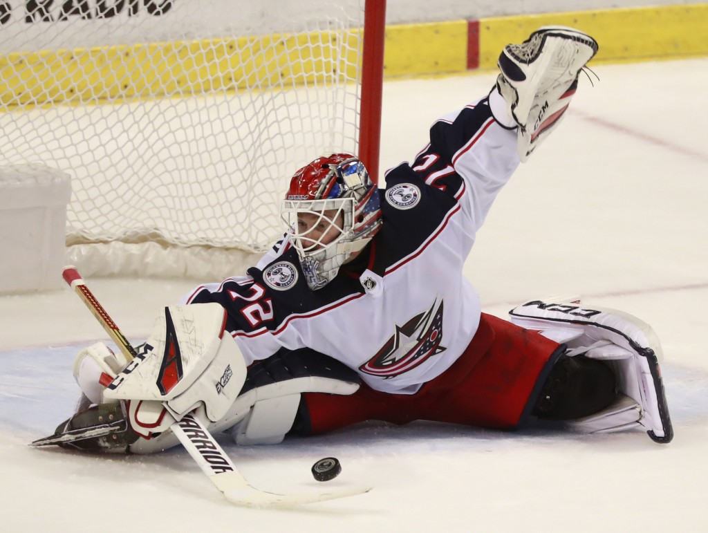 File- This Jan. 5, 2019, file photo shows Columbus Blue Jackets goaltender Sergei Bobrovsky (72) making a save during the third period of an NHL hocke...