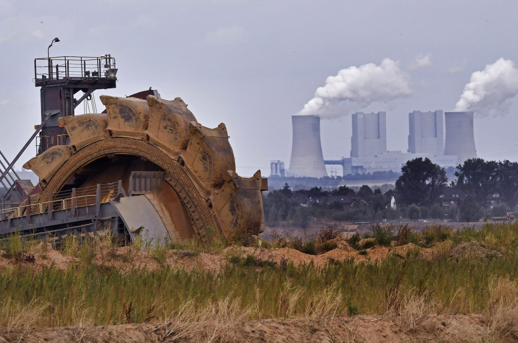 File--- In this photo taken Aug. 27, 2018  bucket wheel digs for coal near the Hambach Forest near Dueren, Germany. (AP Photo/Martin Meissner)