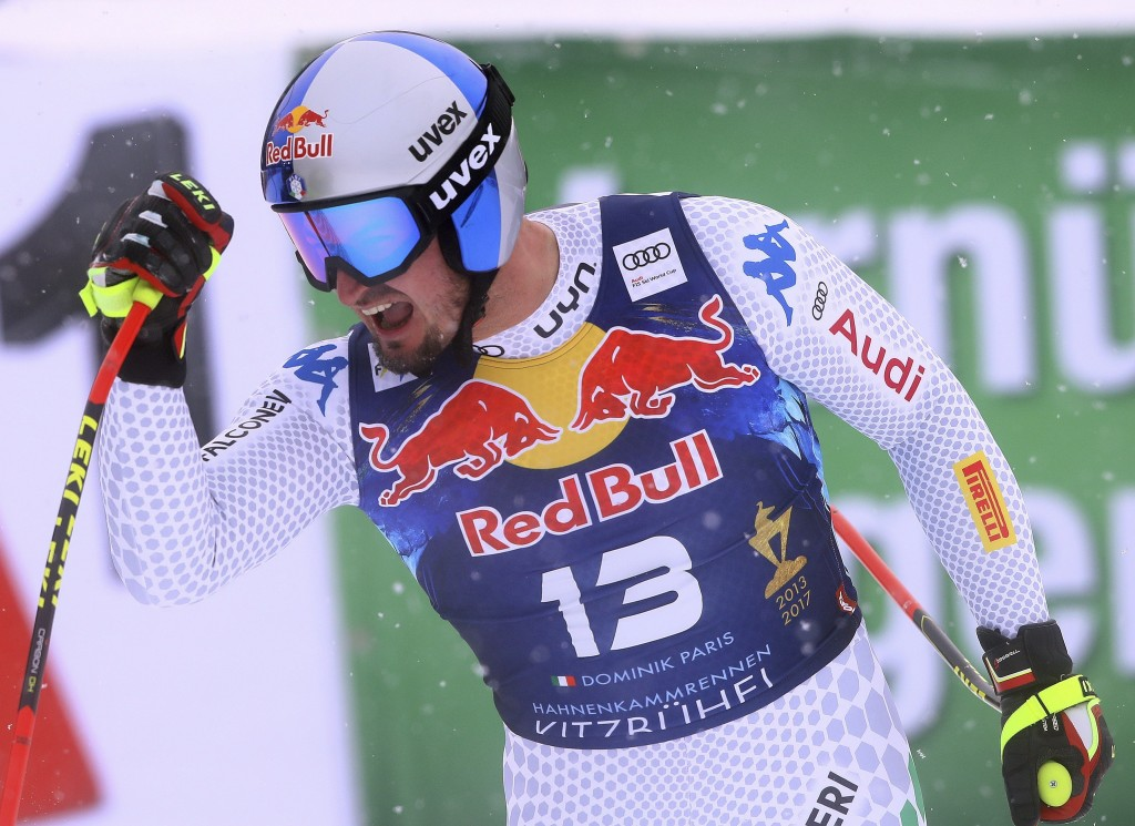 Italy's Dominik Paris celebrates at the finish area of an alpine ski, men's World Cup downhill, in Kitzbuehel, Austria, Friday, Jan. 25, 2019. (AP Pho...