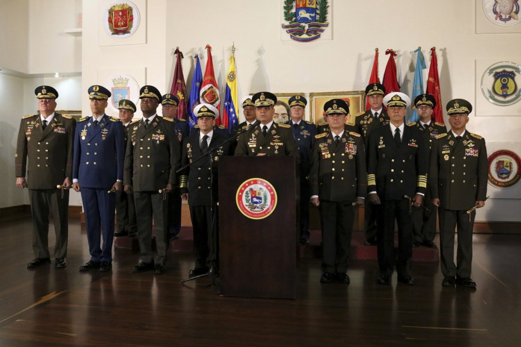 In this photo released by the Venezuelan Defense Ministry press office, Defense Minister Vladimir Padrino Lopez delivers a message of support for Vene...
