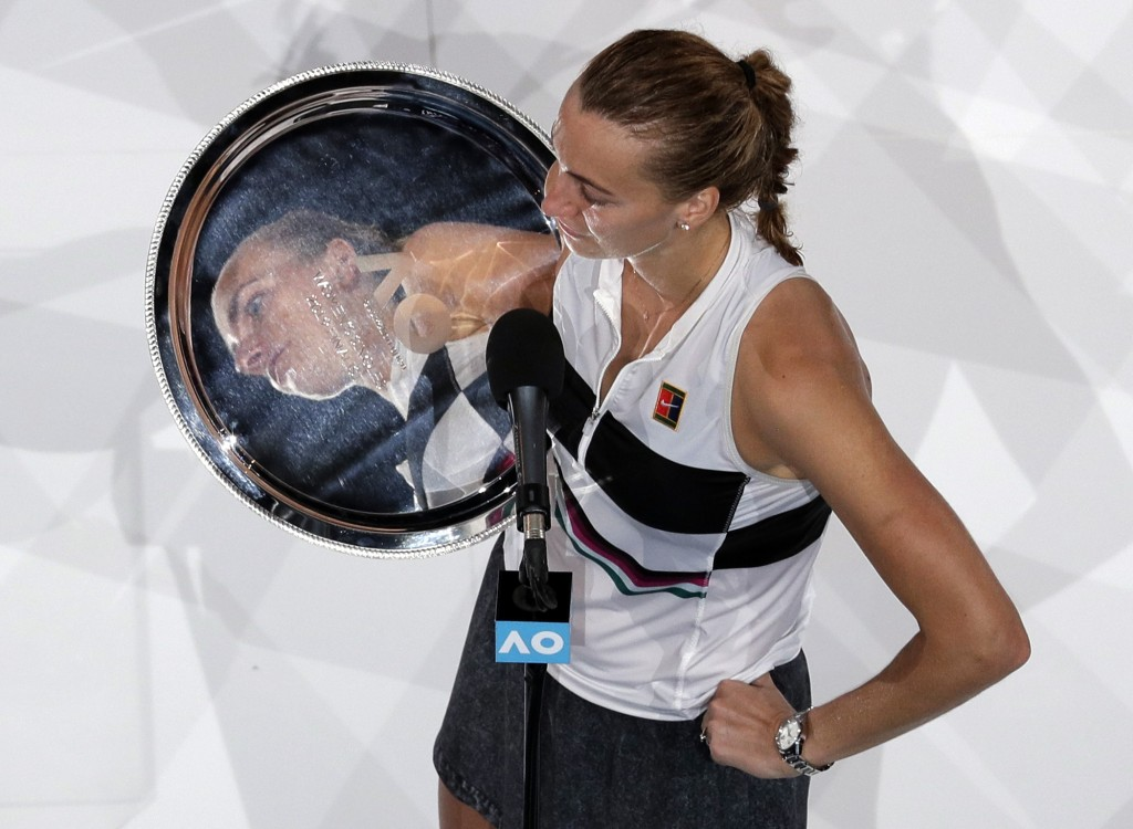 Petra Kvitova of the Czech Republic holds her trophy as she speaks after losing to Japan's Naomi Osaka in the women's singles final at the Australian ...