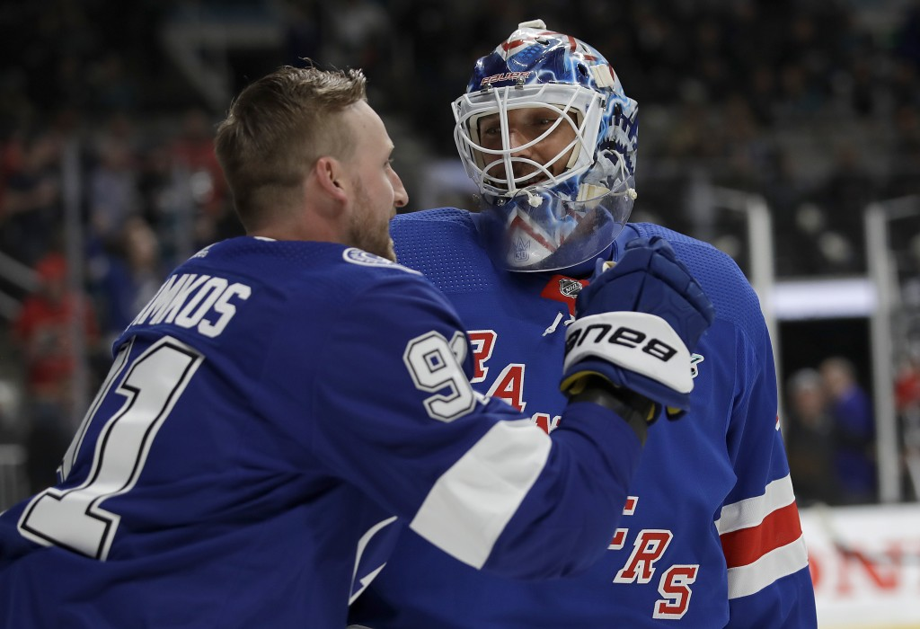 Tampa Bay Lightning's Steven Stamkos, left, talks with New York Rangers' Henrik Lundqvist during the skills competition, part of the NHL hockey All-St