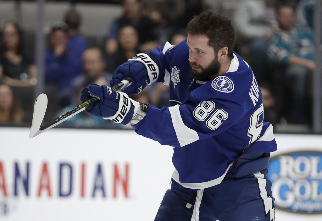 Tampa Bay Lightning's Nikita Kucherov watches a puck in the accuracy shooting event during the skills competition, part of the NHL hockey All-Star wee