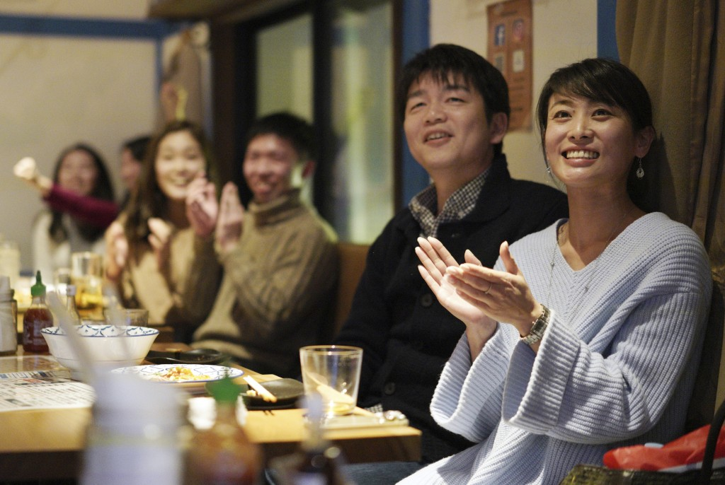 Fans at a restaurant in Tokyo celebrate as Japan's Naomi Osaka wins against Czech Republic's Petra Kvitova at the Australian Open tennis women's final