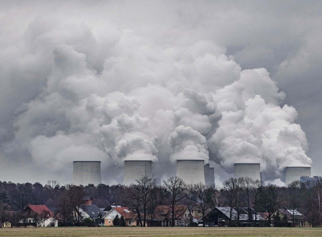 FILE---In this  Jan.6, 2019 file photo water vapour rises from the cooling towers of the Joenschwalde lignite-fired power plant of Lausitz Energie Ber...