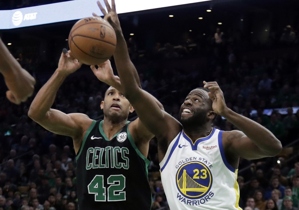 Golden State Warriors forward Draymond Green (23) knocks the ball loose from Boston Celtics center Al Horford (42) in the first quarter of an NBA bask