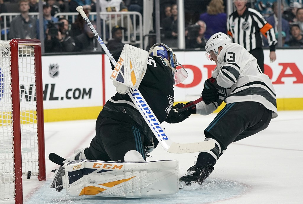 Metropolitan Division's Cam Atkinson, right, of the Columbus Blue Jackets, scores against Central Division's Pekka Rinne, of the Nashville Predators,