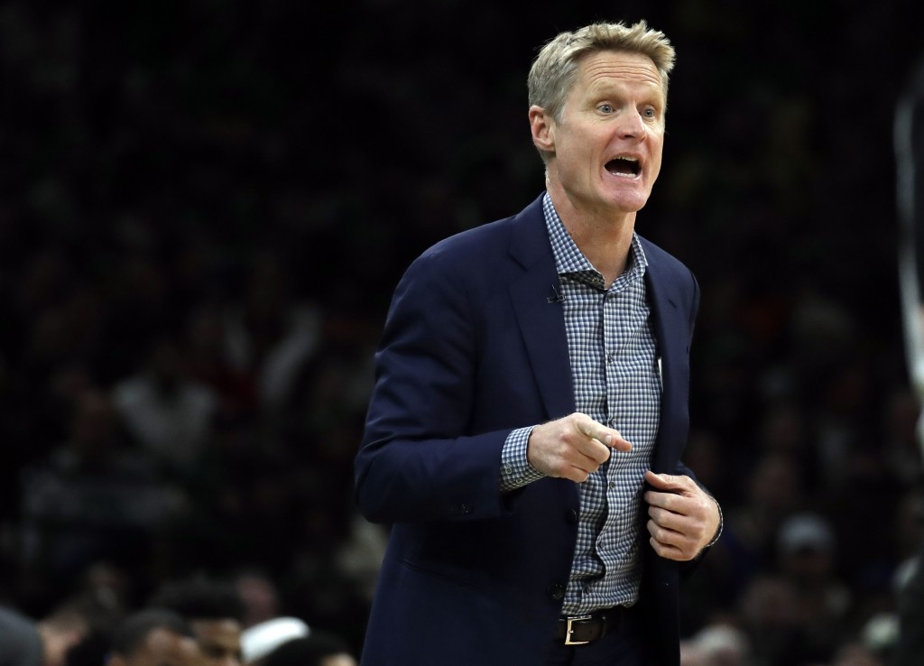 Golden State Warriors head coach Steve Kerr instructs his team in the first quarter of an NBA basketball game against the Boston Celtics, Saturday, Ja
