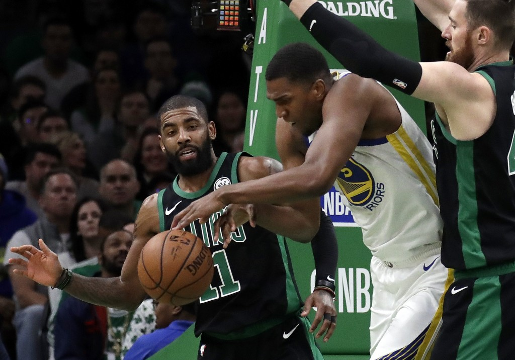 Golden State Warriors center Kevon Looney (5) tries to maintain control of the ball against Boston Celtics guard Kyrie Irving (11) and center Aron Bay