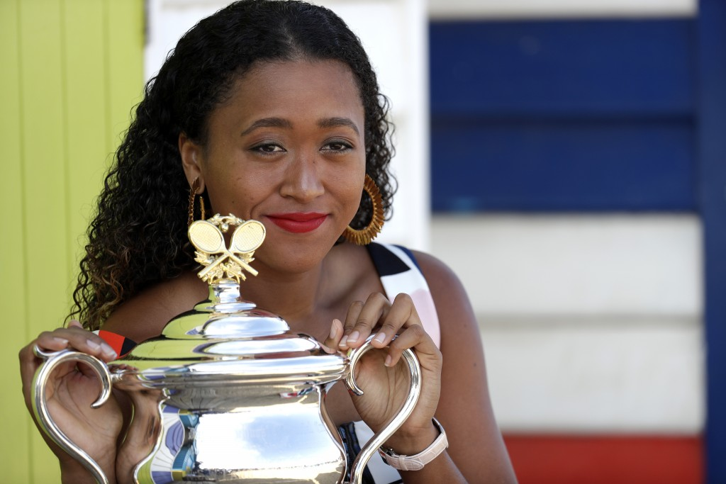 Japan's Naomi Osaka poses with her trophy the Daphne Akhurst Memorial Cup at Melbourne's Brighton Beach following her win over Petra Kvitova of the Cz