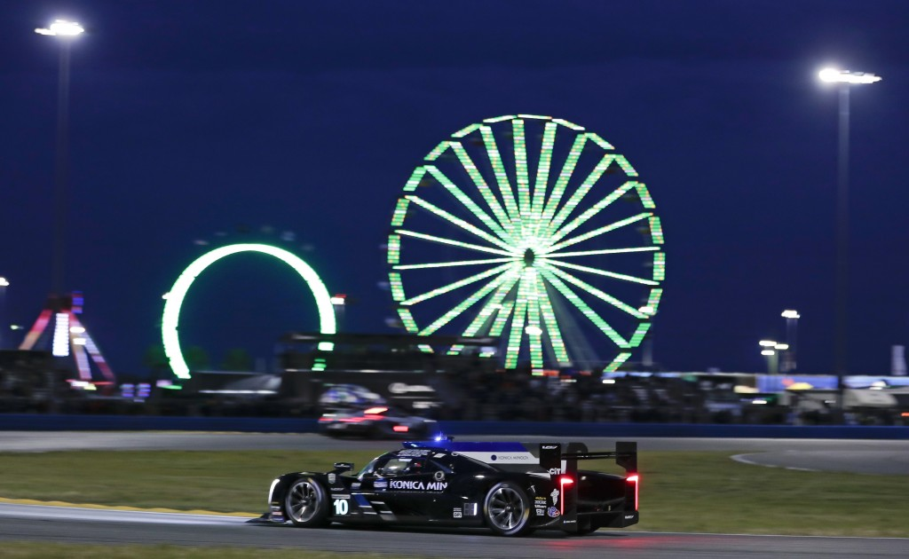 Fernando Alonso drives his Cadillac DPi during the evening hours of the IMSA 24-hour race at Daytona International Speedway, Saturday, Jan. 26, 2019, ...