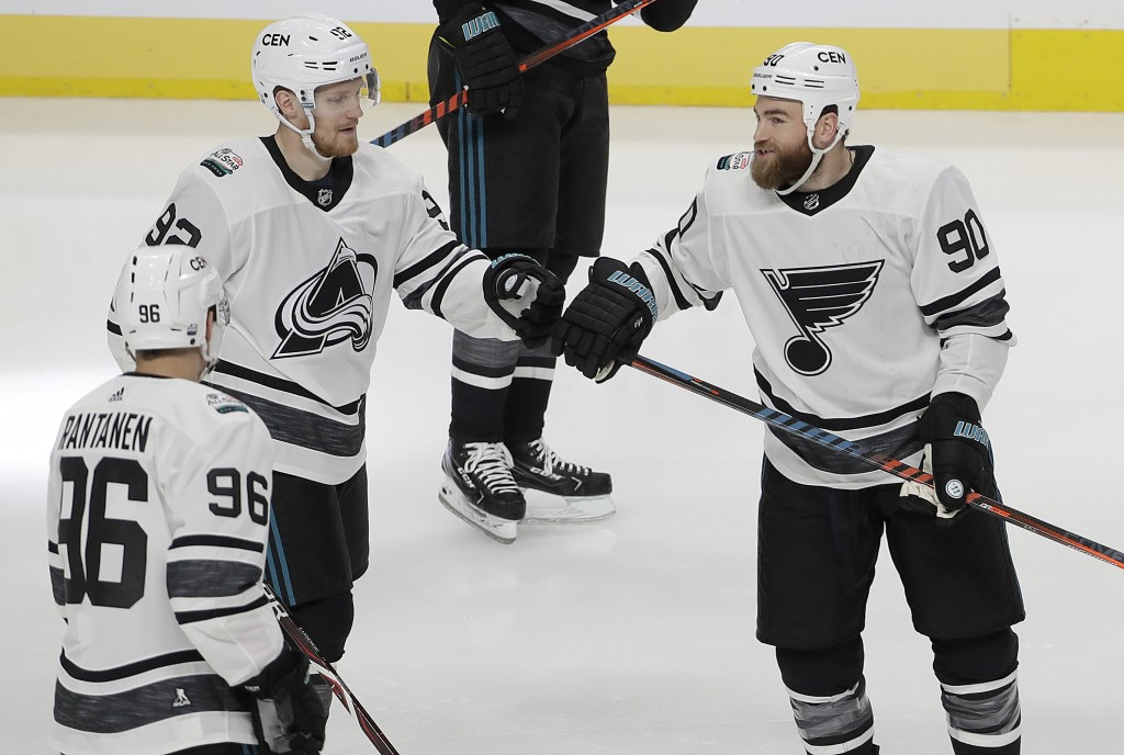 Central Division's Gabriel Landeskog, top left, of the Colorado Avalanche, is congratulated by Mikko Rantanen (96) and Ryan O'Reilly after scoring a g